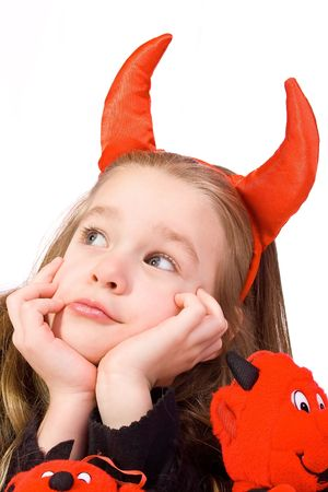 Young Child Dressed in a Devil Costume on White Background photo