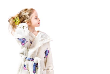 toyshop: young girl with bathrobe on white background Stock Photo