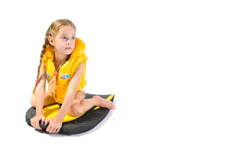 preteens beach: young girl with yollow lifejacket Stock Photo