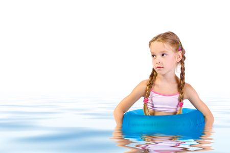 preteens beach: young girl with blue lifering Stock Photo