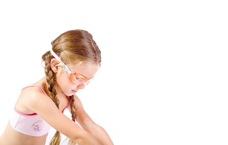 preteens beach: Young girl as swimmer with glasses Stock Photo