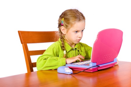 gripping hair: Sitting young girl with notebook Stock Photo