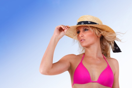 Sexy young girl with hat and swimsuit over blue sky Stock Photo - 12508317