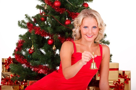 Beautiful Christmas girl in red with bell photo