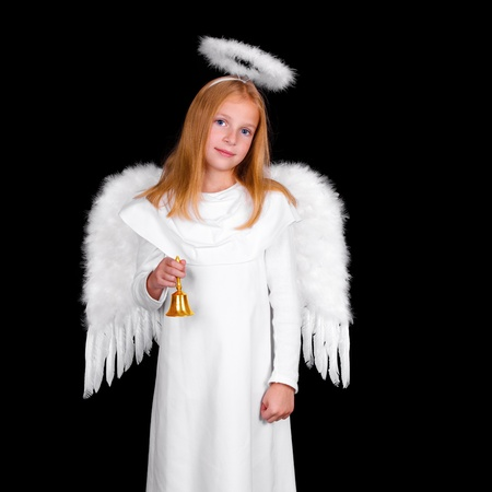 aureole: Young girl as christmas angel on black background