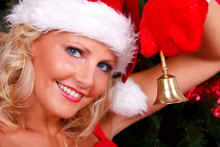 chink: Beautiful Christmas girl in red with bell