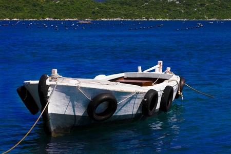 pleasure boat: Lonely fishing boat on sea