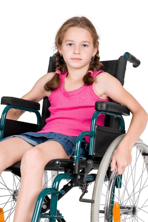 Young handicapped girl in a wheelchair over white background  photo
