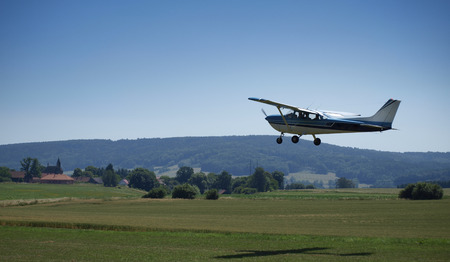 cessna: small airplane with summer landscape