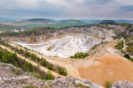 dragline: Limestone mine in Koneprusy, Czech Republic. Deep opencast mines leave great environmental impact.