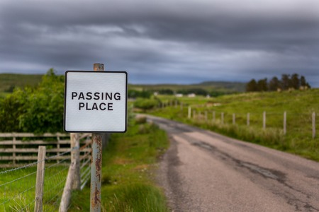 Mull: Passing place sign in Scottish Highlands. TravelWanderlust concept Stock Photo