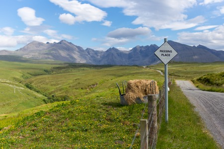 Passing place sign in Scottish Highlands. TravelWanderlust concept Stock Photo