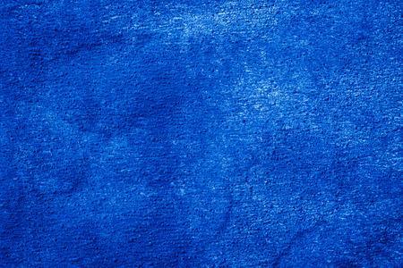 研磨テクスチャ屋根ふき材料クローズ アップ。背景暗い粒状。