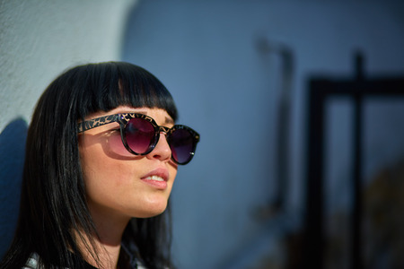 Beautiful young girl with black hair, sunglasses. Youth, happiness, summer sunny day, portrait Stock Photo