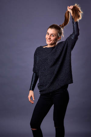 homogeneous: Beautiful sexy girl in casual clothes posing in photo studio on a homogeneous background. Womans portrait, emotions