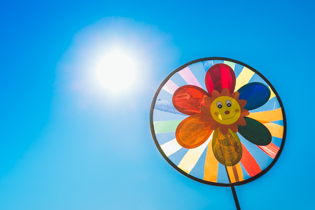 definition high: Childrens pinwheel in windy weather Stock Photo