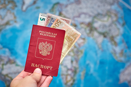 Russian passport and Euro banknotes on the map background 写真素材