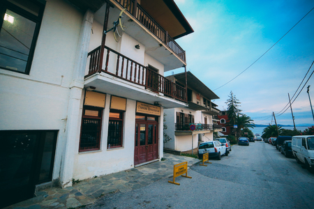 Ouranoupoli, GREECE - SEPTEMBER 23, 2014: Greek street with church shops 新聞圖片