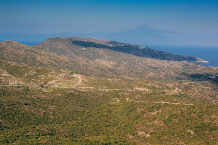 a view of the mountains and the Mediterranean Sea on a sunny summer day. Greece, travel.