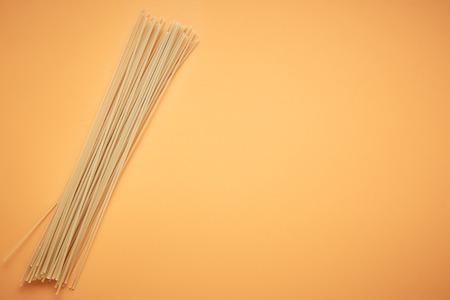 Italian spaghetti on orange background
