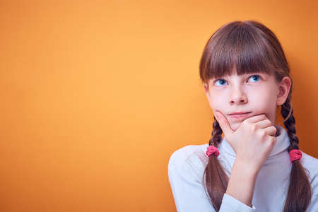 reflections, Caucasian teen girl thinking on colored background, place for text