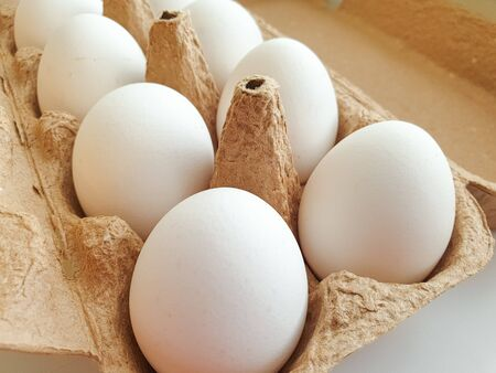 cardboard box with white chicken eggs, farm product