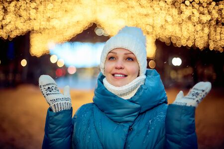 portrait of a woman in a winter Park in the evening, Christmas decorations, tourism and travel.