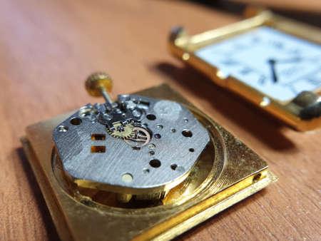 movement of a wristwatch close-up, repair of a broken watch