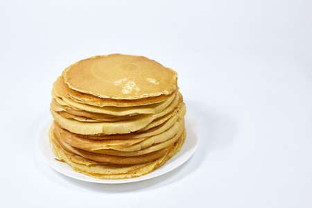 a stack of Russian pancakes on a white background, pancakes on Shrovetide before Lent