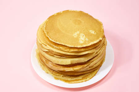 a stack of Russian pancakes on a pink background, pancakes on Shrovetide before Lent 写真素材