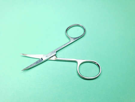 nail scissors on a green background, taken on a mobile phone Imagens