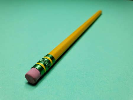 stationery pencil on a green background