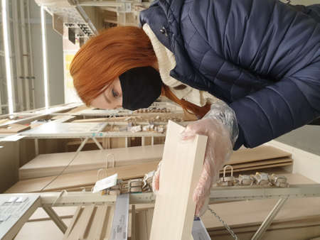 woman in medical furniture laminated chipboard sheets in a construction store 写真素材
