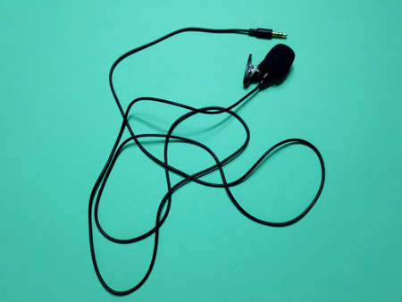 phone microphone with mini jack connector on green background