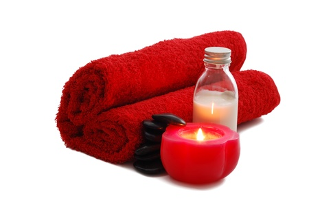 Romantic Valentine Day SPA set with candle including heart shaped towel, moisturizer and  pebbles on white background