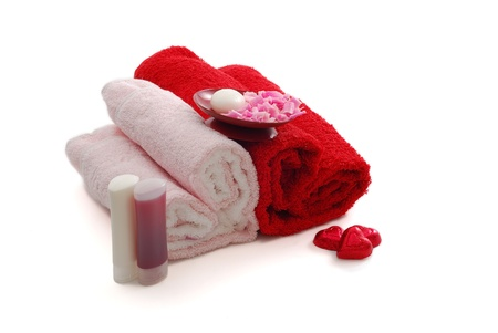 Romantic Valentine Day SPA set including heart shaped towels, soap, candies on white background