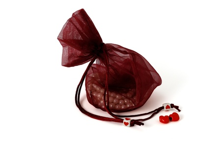 Valentine day gift, beads in pouch  on white background