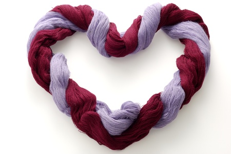 Bicolor skein of wool in shape of heart photo