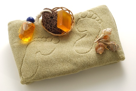 Beige foot SPA set with soap, pumice and shells on towel with footprints Stock Photo - 8630602