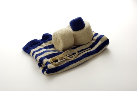 Blue white stripped knitting with clews and knitting needles