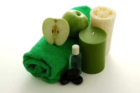 Green apple flavored SPA set including green towel, sponge, shampoo, pebbles and candle Stock Photo - 8703962