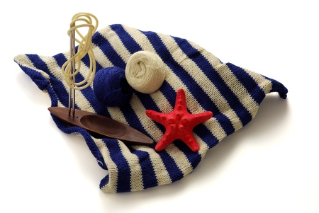 Marine theme in knitting  with blue and white clews, knitting needles and starfish