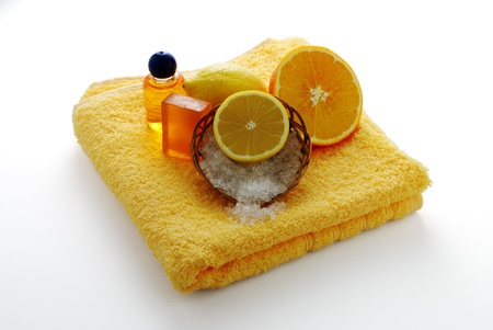 Citrus flavored SPA set including soap, salt and  shampoo on yellow towel Stock Photo - 8802045