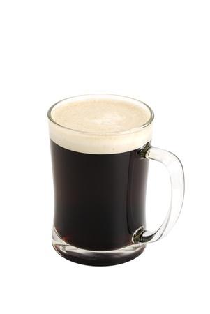 Dark beer in glass on white background