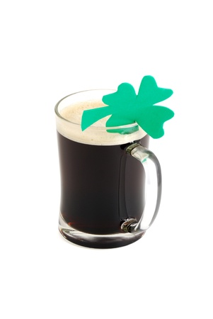 Glass of dark beer decorated with 4-leaf clover on white background Stock Photo - 8802050