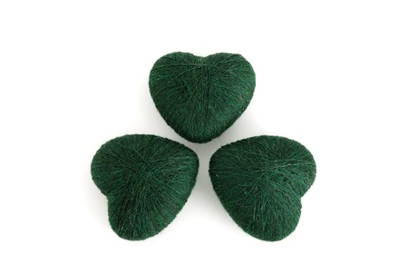 3-leaf clover (shamrock) formed out of green  heart shaped clews on white background Stock Photo - 8802082