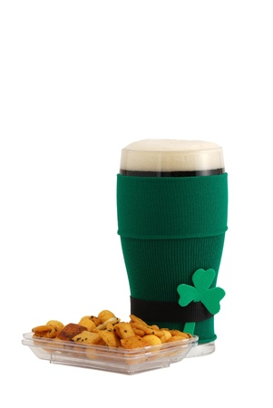 st patrick day: Beer snack and full beer glass in green with black belt leprechaun suit for St Patrick day celebration decorated with shamrock isolated on white background Stock Photo