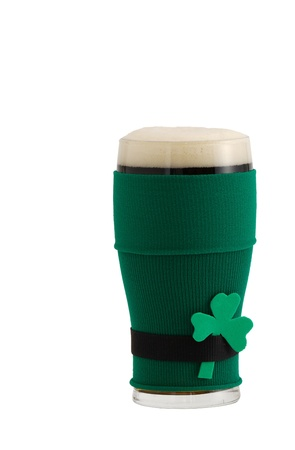 st patrick day: Full beer glass in green with black belt leprechaun suit for St Patrick day celebration decorated with shamrock  Stock Photo