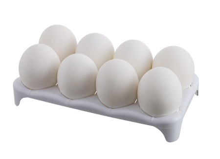 Eight white eggs in white carton isolated on white background
