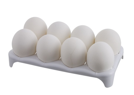 Eight white eggs with one cracked in white carton isolated on white background photo